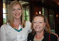 NWA Democrat-Gazette/CARIN SCHOPPMEYER Caroline Rochelle, University Women's Giving Circle president (left) and Sandy Steinmetz visit at the April 20 reception.