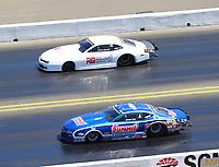 Jul 30, 2017; Sonoma, CA, USA; NHRA pro stock driver Jason Line (near) races alongside Steve Graham during the Sonoma Nationals at Sonoma Raceway. Mandatory Credit: Mark J. Rebilas-USA TODAY Sports