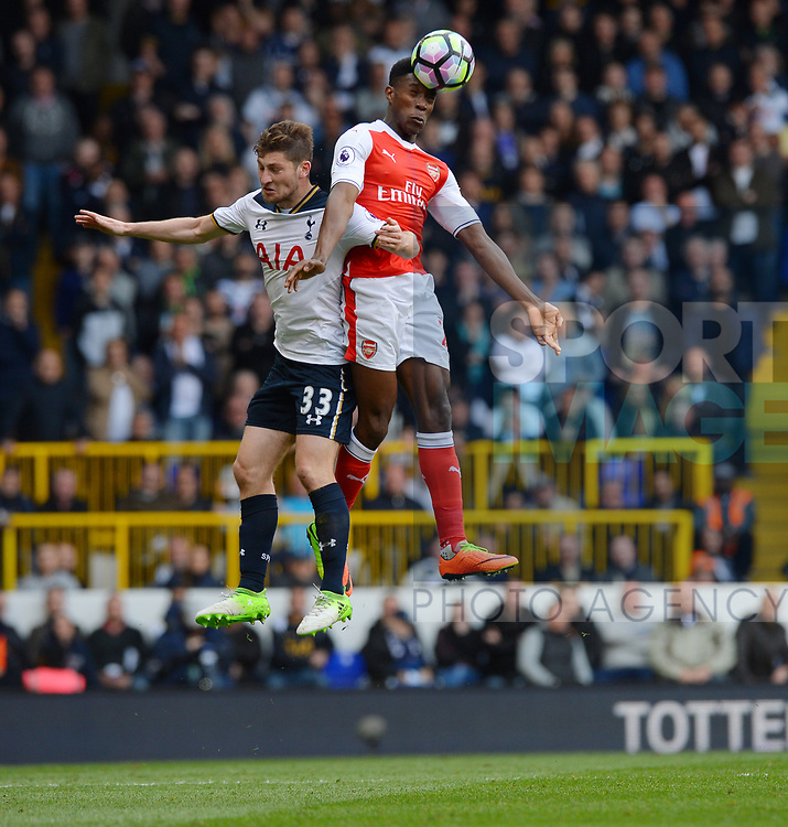 Danny Welbeck of Arsenal is challenged by Ben Davies of Tottenham Hotspur during the English Premier League match at the White Hart Lane Stadium, London. Picture date: April 30th, 2017.Pic credit should read: Robin Parker/Sportimage