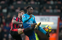 Danny Welbeck of Arsenal & Steve Cook of AFC Bournemouth during the Premier League match between Bournemouth and Arsenal at the Goldsands Stadium, Bournemouth, England on 14 January 2018. Photo by Andy Rowland.