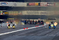 Feb 8, 2014; Pomona, CA, USA; NHRA top fuel dragster driver Richie Crampton (left) races alongside Sidnei Frigo during qualifying for the Winternationals at Auto Club Raceway at Pomona. Mandatory Credit: Mark J. Rebilas-