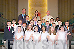 9302-9306.---------.Boys and girls from Holy Family school Tralee,celebrated their 1st Holy communion last Saturday in St Brendan's Church with Fr Patsy Lynch,teacher Elaine O'Sullivan and principal Ed O'Brien were Paige Hallisey,Shelby Lonergan,Sharon Enright,Barbora Dunova,Alice Dwyre,Leanne O'Connor,Sean Quilter,Daragh Hogan,Junior Porojan,Sean O'Driscoll,Paddy Murphy,Dylan Day,Dylan Looney Brosnan,Brian Teehan,Darragh Flynn,Stephan Oprisan,Conor Fitzmorris,Padraig Hughes,James O'Halloran and Nick Izehi..