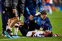 27th November 2019; Mestalla, Valencia, Spain; UEFA Champions League Footballl,Valencia versus Chelsea; Jose Gaya of Valencia CF receives the attentions of Valencia CF Medical team after finishing the game with problems - Editorial Use