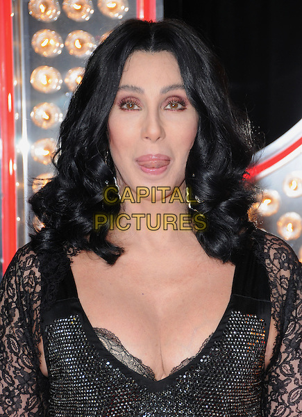 CHER.'Burlesque' Los Angeles Premiere held at The Grauman Chinese Theatre, Hollywood, CA, USA. .November 15th, 2010 .headshot portrait black sparkly lace sleeve low cut cleavage silver wavy hair make-up beauty tongue funny.CAP/RKE/DVS.©DVS/RockinExposures/Capital Pictures.