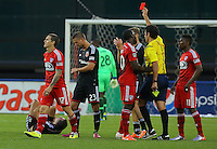 WASHINGTON, D.C - April 26 2014: Referee Fotis Bazakos issues a red card to Zach Loyd  during the D.C. United vs F.C. Dallas MLS match at RFK Stadium, in Washington D.C. United won 4-1.