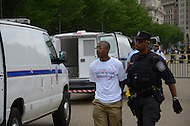 June 25, 2011 (Washington, DC) Nathan Bennett-Fleming, 26, is arrested outside of the White House protesting what he and others consider unfair treatment of District of Columbia residents. The House Appropriations Committee passed a bill that would prohibit DC from using local tax dollars to provide reproductive healthcare for low-income women.  Many residents feel that Congress too often interferes in local government affairs.  The arrests come just over two months after Mayor Vincent Gray and several city council members were arrested in front of the Dirksen Senate Office Building on April 11, 2011, during a protest opposing congressional oversight of the city's budget. (Photo: Don Baxter/Media Images International)