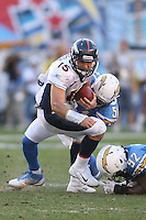 11/27/11 San Diego, CA: Denver Broncos quarterback Tim Tebow #15 and San Diego Chargers inside linebacker Takeo Spikes #51 during an NFL game played between the Denver Broncos and the San Diego Chargers at Qualcomm Stadium. The Broncos defeated the Chargers 16-13 in OT