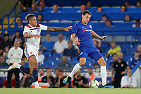 Andreas Christensen of Chelsea passes the ball upfield as Lyon's Mariano Diaz tries to make a challenge during Chelsea vs Lyon, International Champions Cup Football at Stamford Bridge on 7th August 2018