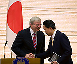 "Australian Prime Minister Kevin Rudd and his Japanese counterpart Yukio Hatoyama shake hands after launching a report titled ""Eliminating nuclear threats: a practical agenda for global policymakers"" at the Japanese prime minister's offices in Tokyo, Japan on Tuesday Dec. 15 2009..Photographer: Robert Gilhooly."
