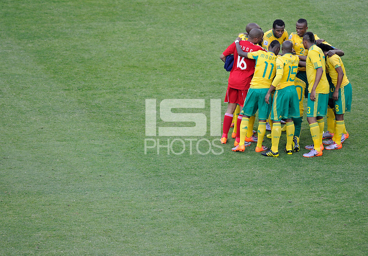 The South African players huddle up prior to kick-off