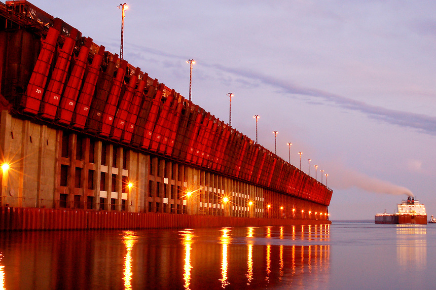 An ore boat leaving the dock in Marquette, MI at sunset.