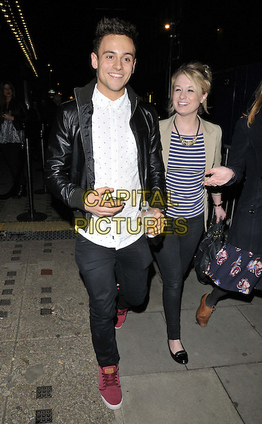 LONDON, ENGLAND - FEBRUARY 27: Tom Daley &amp; guest attend the &quot;War Horse&quot; NT Live gala performance, The New London Theatre, Drury Lane, on Thursday February 27, 2014 in London, England, UK.<br /> CAP/CAN<br /> &copy;Can Nguyen/Capital Pictures