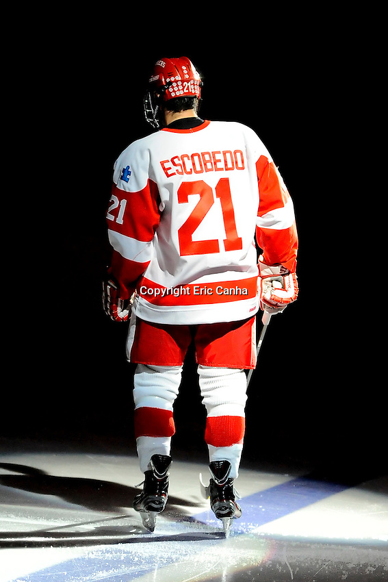 Boston University Terriers defenseman Sean Escobedo (21)  is introduced at the opening of  the Boston College vs Boston University NCAA hockey match played at the Agganis Arena, in Boston Massachusetts.  Eric Canha/CSM