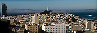 Panoramic view of Telegraph Hill in San Francisco. Sanfrancisco Bay in background. Fog rolling in from the Pacific Ocean.