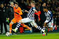 3rd March 2020; The Hawthorns, West Bromwich, West Midlands, England; English FA Cup Football, West Bromwich Albion versus Newcastle United; Javier Manquillo of Newcastle United attempts to beat Chris Brunt of West Bromwich Albion