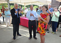 NWA Democrat-Gazette/MICHAEL WOODS • @NWAMICHAELW<br /> Walt Eilers, Board President, (from left) and outgoing director Ron Cox, applaud as they introduce Charlotte Taylor, the Botanical Garden of the Ozarks' new executive director Thursday September 10, 2015 during a reception at the gardens in Fayetteville.