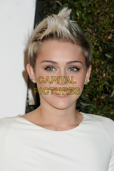 Miley Cyrus .21st Annual Elton John Academy Awards Viewing Party held at West Hollywood Park, West Hollywood, California, USA..February 24th, 2013.oscars headshot portrait white spiked platinum quiff dark buzzed roots hair dyed blonde earrings .CAP/ADM/BP.©Byron Purvis/AdMedia/Capital Pictures.