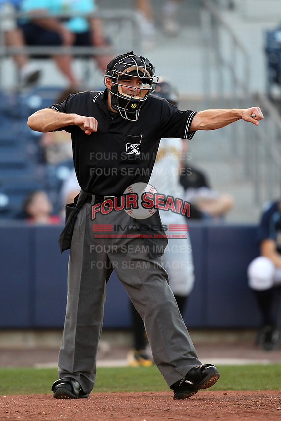 Home plate umpire Ramon Hernandez makes a call in a game between the Charlotte Stone Crabs and Bradenton Marauders at Charlotte Sports Park on April 27, 2012 in Port Charlotte, Florida.  Bradenton defeated Charlotte 9-2.  (Mike Janes/Four Seam Images)