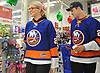 "Anders Lee of the New York Islanders and Grace Dooley fill their cart with presents at Toys ""R"" Us in Carle Place during the team's holiday shopping for children in hospitals on Thursday, Nov. 30, 2017. The gifts will be hand-delivered by the players to children in eight local hospitals on Monday, Dec. 18."