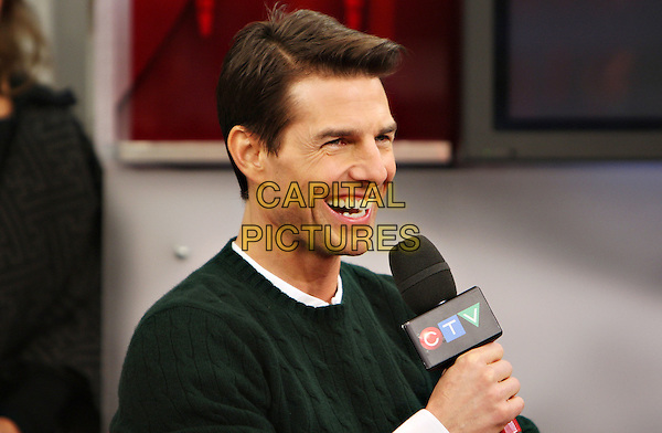 "TOM CRUISE.Actor Tom Cruise visits ETalk Studios to discuss and promote his film ""Valkyrie"", Toronto, Ontario, Canada..December 9th, 2008.headshot portrait microphone green jumper  .CAP/ADM/BPC.©Brent Perniac/AdMedia/Capital Pictures."
