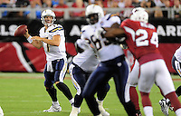 Aug. 22, 2009; Glendale, AZ, USA; San Diego Chargers quarterback (17) Phillip Rivers drops back to pass in the first half against the Arizona Cardinals during a preseason game at University of Phoenix Stadium. Mandatory Credit: Mark J. Rebilas-