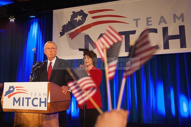 United States Minority Leader Mitch McConnell and his wife Elaine Chao speak to the crowd at his victory celebration after defeating challenger Alison Lundergan Grimes in Louisville, Ky.,on Tuesday, November 4, 2014. Photo by Michael Reaves | Staff