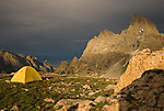The Grand Teton looms behind a campsite in the high alpine of the Teton Range, Wyoming.