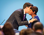 © Joel Goodman - 07973 332324 . No syndication permitted . 25/09/2013 . Brighton , UK . Ed Miliband kisses guest speaker , Doreen Lawrence OBE , after her address to the conference this afternoon (Wednesday 25th September 2013) . Day 4 of the Labour Party 's annual conference in Brighton . Photo credit : Joel Goodman