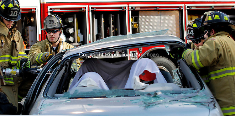 Southbury, CT- 17, October 2010-101710CM07 Southbury Volunteer Firefighter use the jaws of life to cut off the roof during a mock vehicle extrication Sunday afternoon at the Department's headquarter's on Main St. in Southbury.  The event was part of an open house which featured Soutbury's Police Department,  EMS and fire personnel.  The victim's in the auto-extrication were, Southbury First Selectman, Bill Davis, Board of Selectman member, John Turck, Dr. Ron Clark, of Southbury and an ER Doctor at New Britain General and Kurt Mazorsky, President of the Southbury Business Association. Christopher Massa Republican-American
