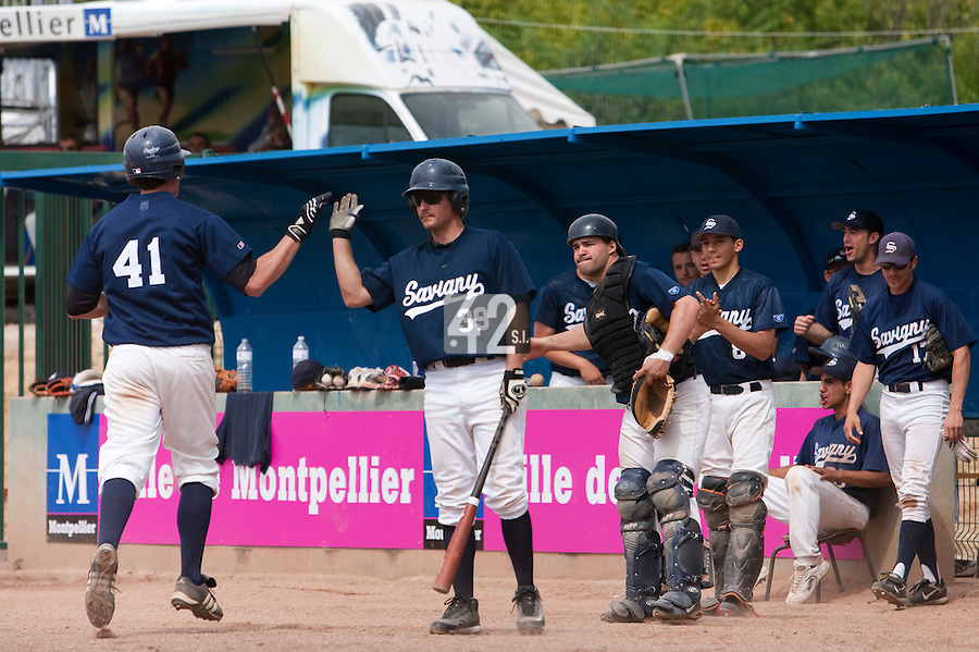 23 May 2009: Romain Martinez-Scott of Savigny congratulates Tim Stewart during the 2009 challenge de France, a tournament with the best French baseball teams - all eight elite league clubs - to determine a spot in the European Cup next year, at Montpellier, France. Savigny wins 4-1 over Senart.