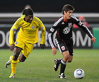 DC United defender Rodrigo Brasesco (3) shields the ball against Columbus Crew forward Andres Mendoza (10)   DC United defeated The Columbus Crew 3-1  at the home season opener, at RFK Stadium, Saturday March 19, 2011.