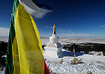 Prayer flags at the Tashi Gomeng Stupa near Crestone, CO. The San Luis Valley is in the background. Michael Brands for The New York Times.