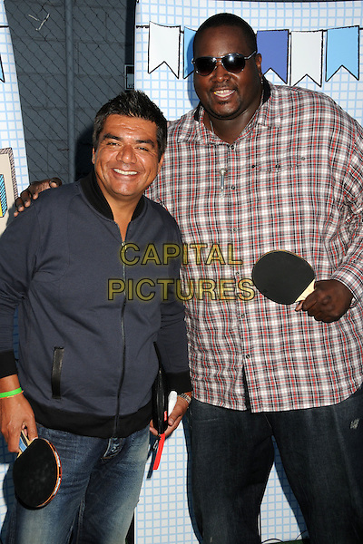 GEORGE LOPEZ & QUINTON AARON .The Ultimate Slam Paddle Jam 2010 Celebrity Ping Pong Tournament held at the Music Box Theatre,  Hollywood, California, USA, 26th September 2010..half length grey gray zip up top jacket arm around tall shirt sunglasses plaid shirt  .CAP/ADM/BP.©Byron Purvis/AdMedia/Capital Pictures.