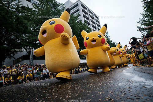 AUGUST 14, 2017 Pikachu characters march during the Pikachu Carnival Parade in Yokohama, south of Tokyo, Japan, 14 August 2017. Some 100 Pikachu, dancers and performers paraded along the streets as part of the 'Pikachu Outbreak!' event. (Photo by Nicolas Datiche/AFLO) (JAPAN)
