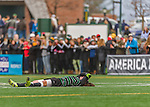 15 November 2015: Binghamton University Bearcat Backfielder Zach Galluzzo, a Junior from Ronkonkoma, NY, lies motionless after the final horn sounds concluding play against the University of Vermont Catamounts at Virtue Field in Burlington, Vermont. The Bearcats fell to the Catamounts 1-0 in the America East Championship Game. Mandatory Credit: Ed Wolfstein Photo *** RAW (NEF) Image File Available ***