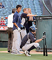 (L-R) Gosuke Kato, Ichiro Suzuki (Yankees),<br /> JUNE 14, 2013 - MLB :<br /> Ichiro Suzuki of the New York Yankees and Yankees second round draft pick Gosuke Katoh take batting practice before the Major League Baseball game against the Los Angeles Angels at Anaheim Stadium in Anaheim, California, United States. (Photo by AFLO)
