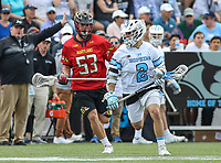 Baltimore, MD - April 28, 2018: Johns Hopkins Blue Jays Alex Concannon (2) is being chased by Maryland Terrapins Drew Harrison (53) during game between John Hopkins and Maryland at  Homewood Field in Baltimore, MD.  (Photo by Elliott Brown/Media Images International)