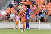 Houston, TX - Saturday June 17, 2017: Janine van Wyk heads the ball over Jasmyne Spencer during a regular season National Women's Soccer League (NWSL) match between the Houston Dash and the Orlando Pride at BBVA Compass Stadium.