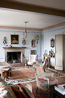 A large Persian rug and hand painted walls create the perfect setting in the living room