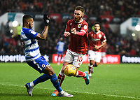 AMatty Taylor of Bristol City is challenged by Leandro Bacuna of Reading during the Sky Bet Championship match between Bristol City and Reading at Ashton Gate, Bristol, England on 26 December 2017. Photo by Paul Paxford.
