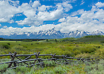 Jackson Hole, WY: Weathered fence line and the Snake River Valley under the majestic Teton Range in summer