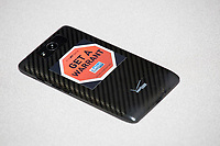 "A sticker for the ACLU reads ""It's My Data / Get a Warrant"" is seen on a cell phone at the Metric Geometry and Gerrymandering Group (MGGG) hackathon at the Data Lab in the Tisch Library at Tufts University in Medford, Massachusetts, USA, on Thurs., Aug. 10, 2017. The hackathon is part of the first in a series of Geometry of Redistricting workshops put on by the MGGG. Academics, Geographic Information Systems (GIS) professionals, and legal professionals worked together to build tools useful in analyzing voting district data around the country."
