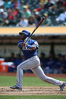 OAKLAND, CA - SEPTEMBER 18:  Elvis Andrus #1 of the Texas Rangers bats against the Oakland Athletics during the game at O.co Coliseum on Thursday, September 18, 2014 in Oakland, California. Photo by Brad Mangin