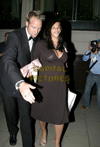 JADE GOODY.TV Quick Awards 2004 At The Dorchester, London, W1.September 6th, 2004.full length, pregnant, bump, being led, carrying bag.www.capitalpictures.com.sales@capitalpictures.com.© Capital Pictures.