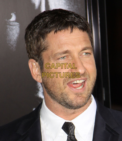 GERARD BUTLER.The Overature Film L.A. Premiere of Law Abiding Citizen held at The Grauman's Chinese Theater in Hollywood, California, USA. .October 6th, 2009 .headshot portrait grey gray black stubble facial hair mouth open.CAP/ADM/KB.©Kevan Brooks/AdMedia/Capital Pictures.