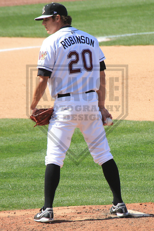 APPLETON - MAY 2010: Chad Robinson of the Wisconsin Timber Rattlers, Class-A affiliate of the Milwaukee Brewers, during a game on May 5, 2010 at Fox Cities Stadium in Appleton, Wisconsin. (Photo by Brad Krause)