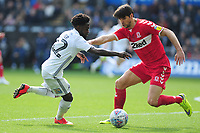 Nathan Dyer of Swansea City vies for possession with George Friend of Middlesbrough during the Sky Bet Championship match between Swansea City and Middlesbrough at the Liberty Stadium in Swansea, Wales, UK. Saturday 06 April 2019