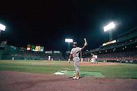 BOSTON, MA - Rickey Henderson of the Oakland Athletics warms up in the on deck circle during game 2 of the 1990 American League Championship Series against the Boston Red Sox at Fenway Park in Boston, Massachusetts in 1990. Photo by Brad Mangin