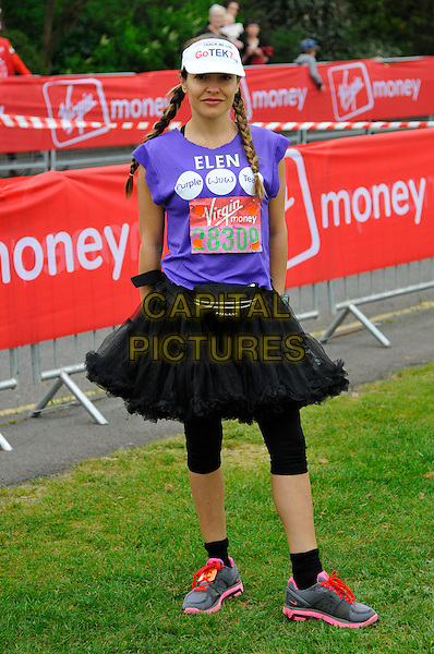 ELEN RIVAS .Virgin London Marathon, Blackheath, London, England..April 17th, 2011.full length purple t-shirt visor hat black leggings tutu skirt braids plaits hair trainers sneakers .CAP/CAS.©Bob Cass/Capital Pictures.
