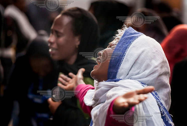 People mourn the death of Prime Minister Meles Zenawi at the state funeral.